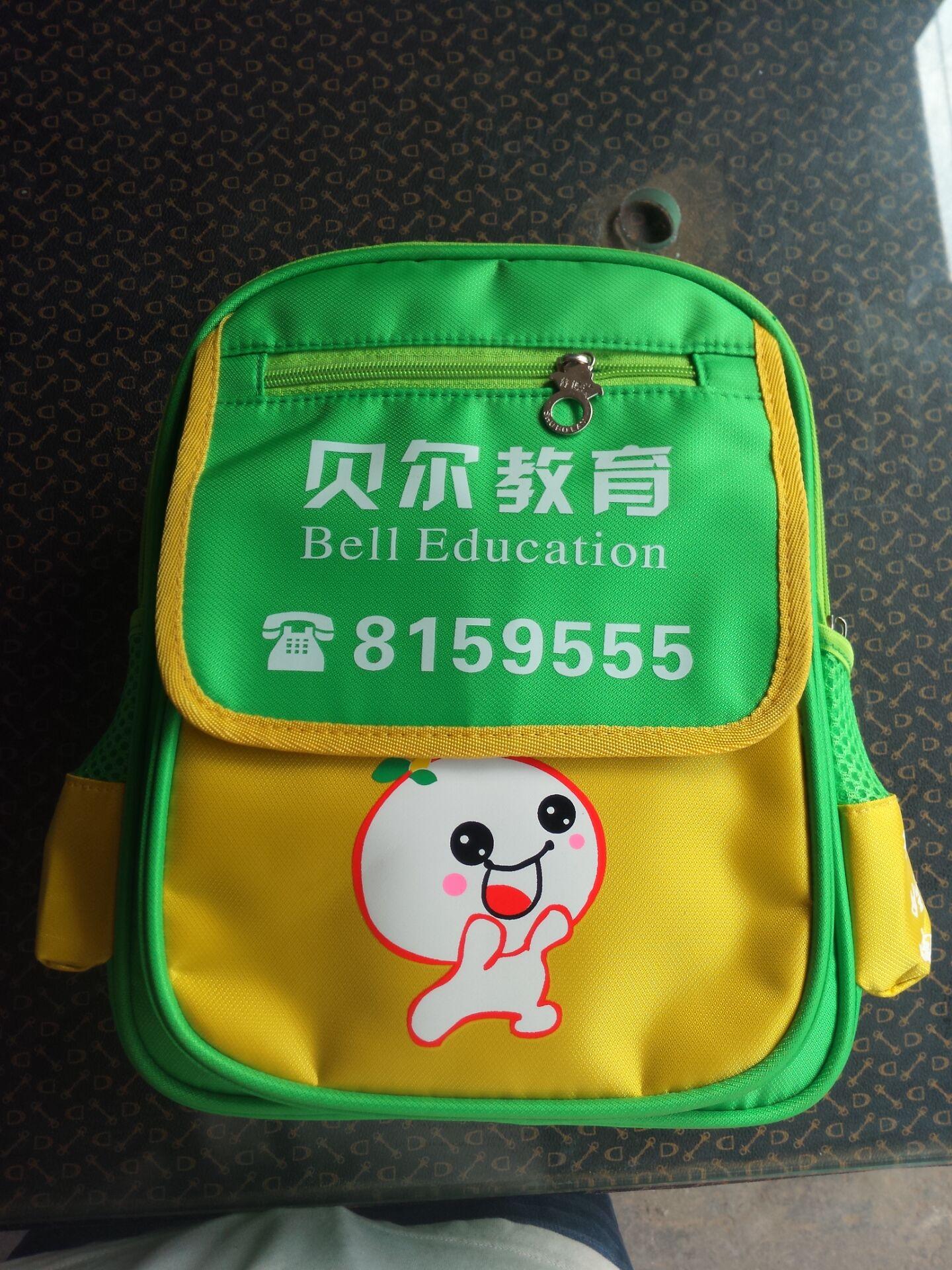 手抄报绿色书包